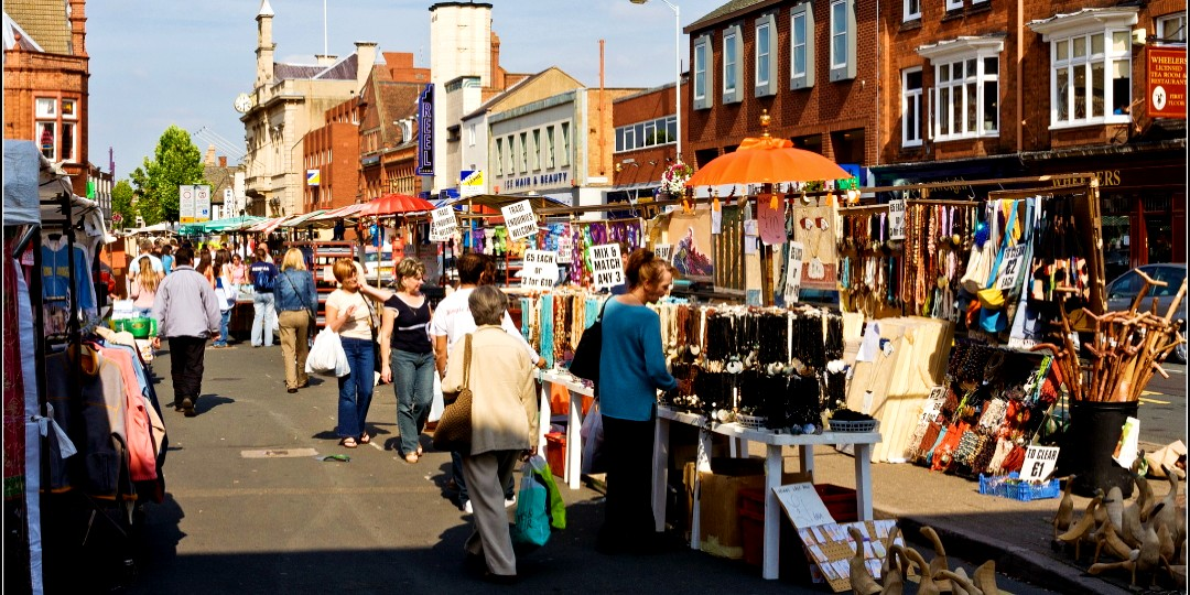 People shopping at Loughborough market