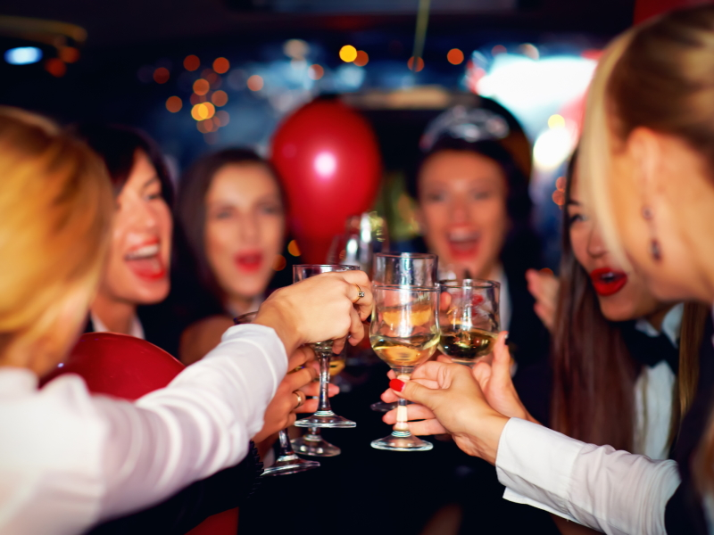 image of partying clients in an 8-seater Kaycabs Mibus taxi